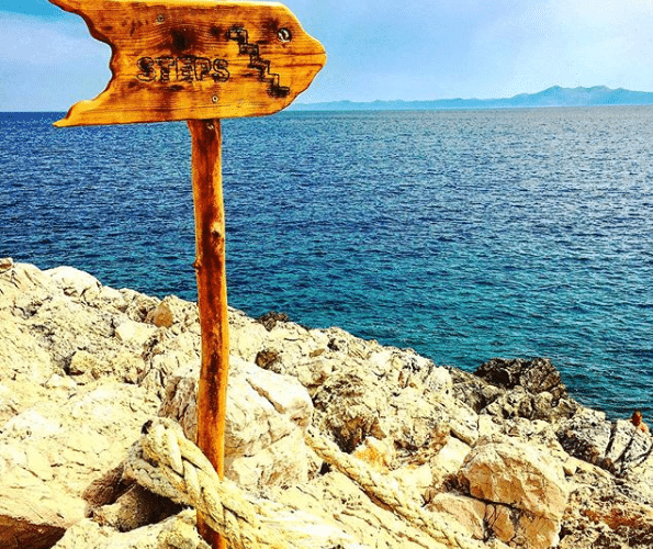 arrow signpost pointing near the sea - first steps of payroll outsourcing