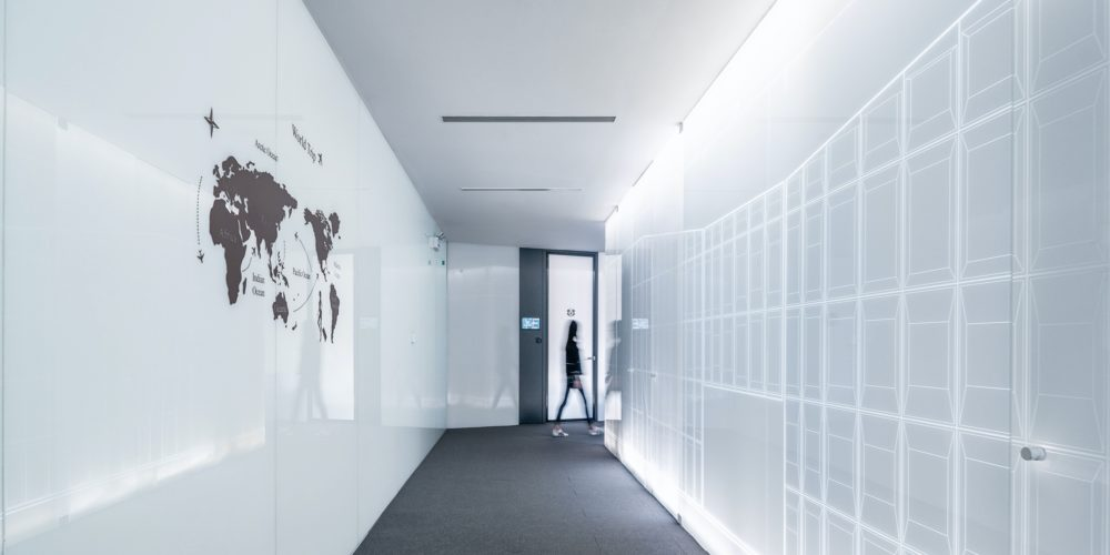 office building corridor with a world map
